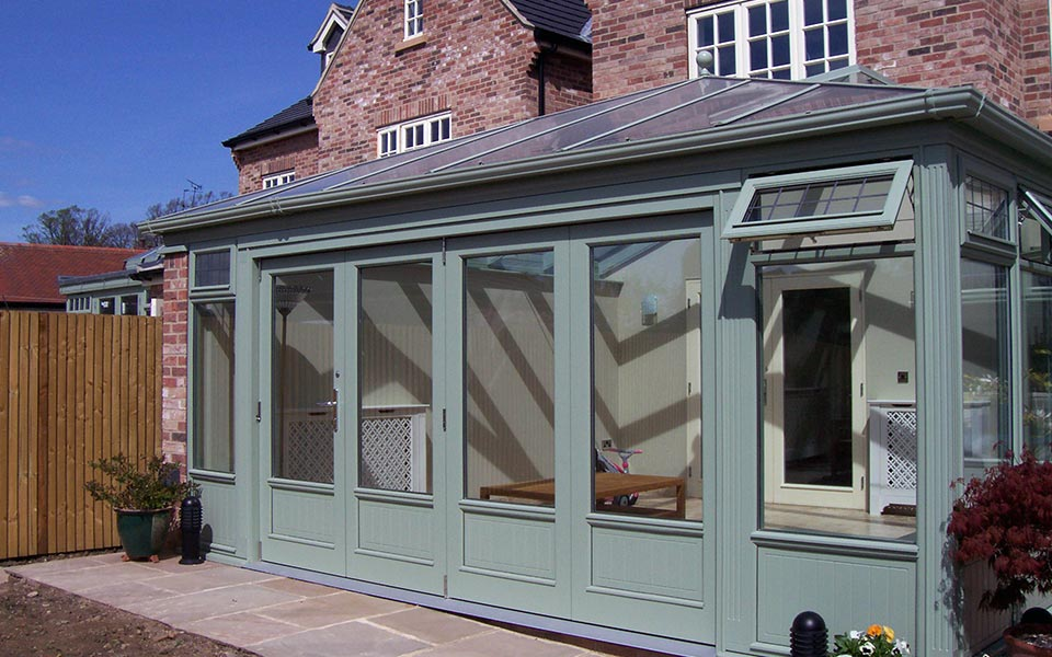 An Accoya timber conservatory painted in Chartwell Green