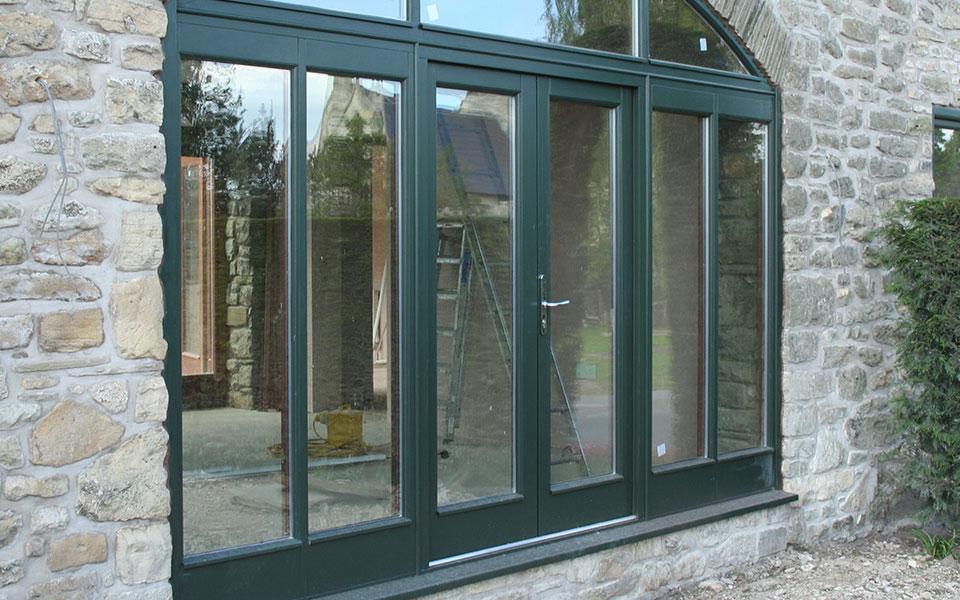 Timber doors manufactured using accoya timber painted grey